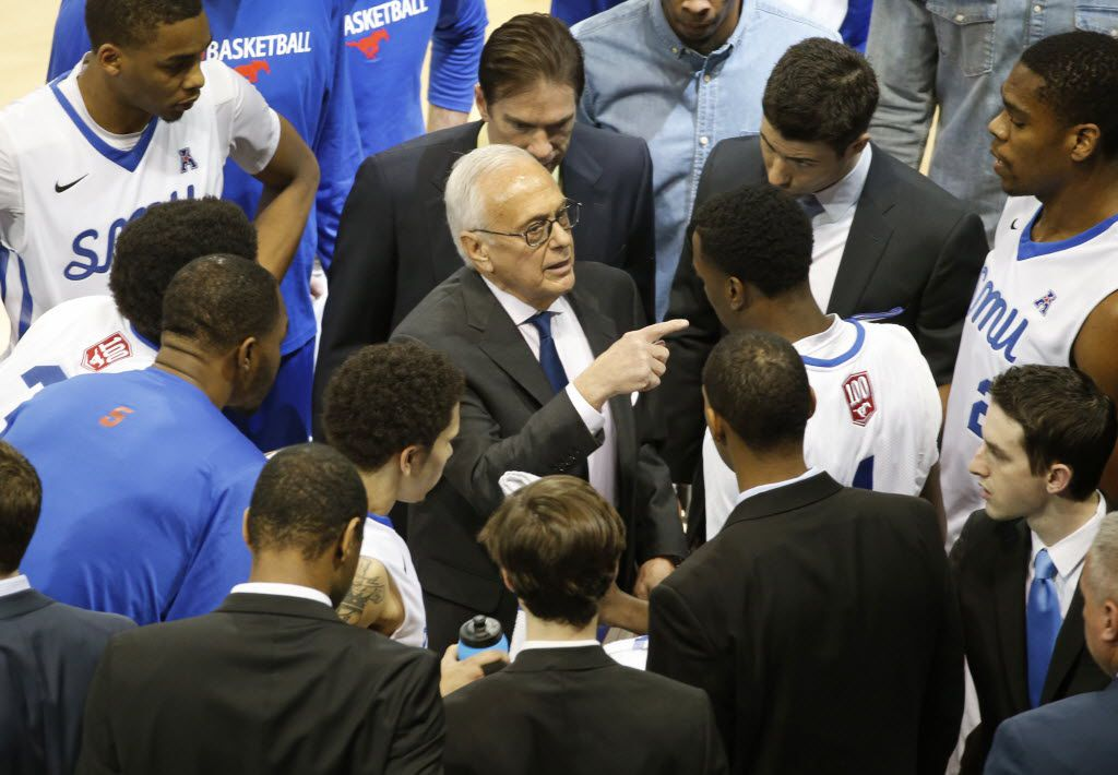 SMU head coach Larry Brown talks with his team during a time out in the first half during the Central Florida University Knights vs. the SMU Mustangs college basketball game at Moody Coliseum in Dallas on Saturday, January 31, 2015.  (Louis DeLuca/The Dallas Morning News)