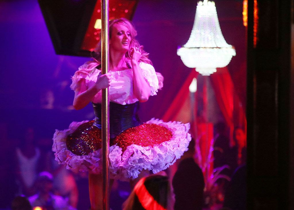 Actress Stephanie Clifford, who uses the stage name Stormy Daniels, performs at the Solid Gold Fort Lauderdale strip club on March 9, 2018, in Pompano Beach, Fla. Stephanie Clifford, who claims to have had an affair with President Trump, has filed a suit against him in an attempt to nullify a nondisclosure deal with Trump attorney Michael Cohen days before Trump's 2016 presidential victory.