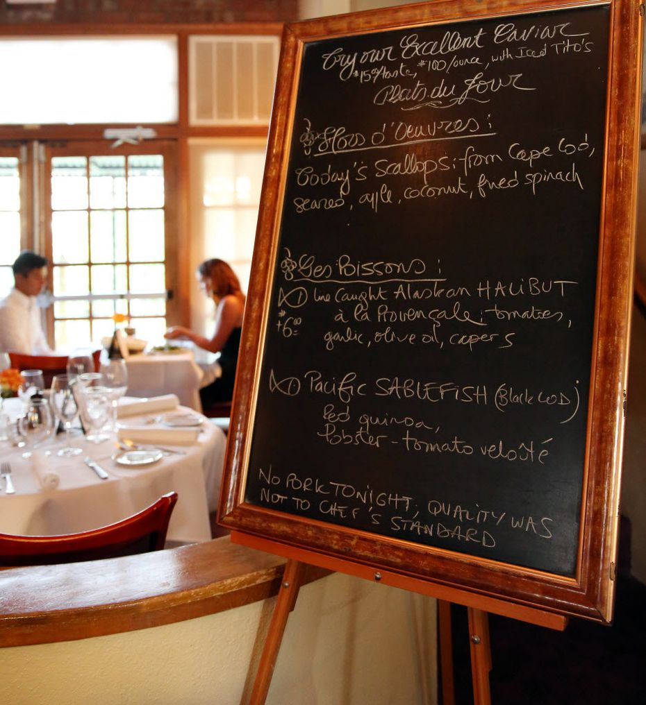 Specials at Saint-Emilion are featured on a blackboard.