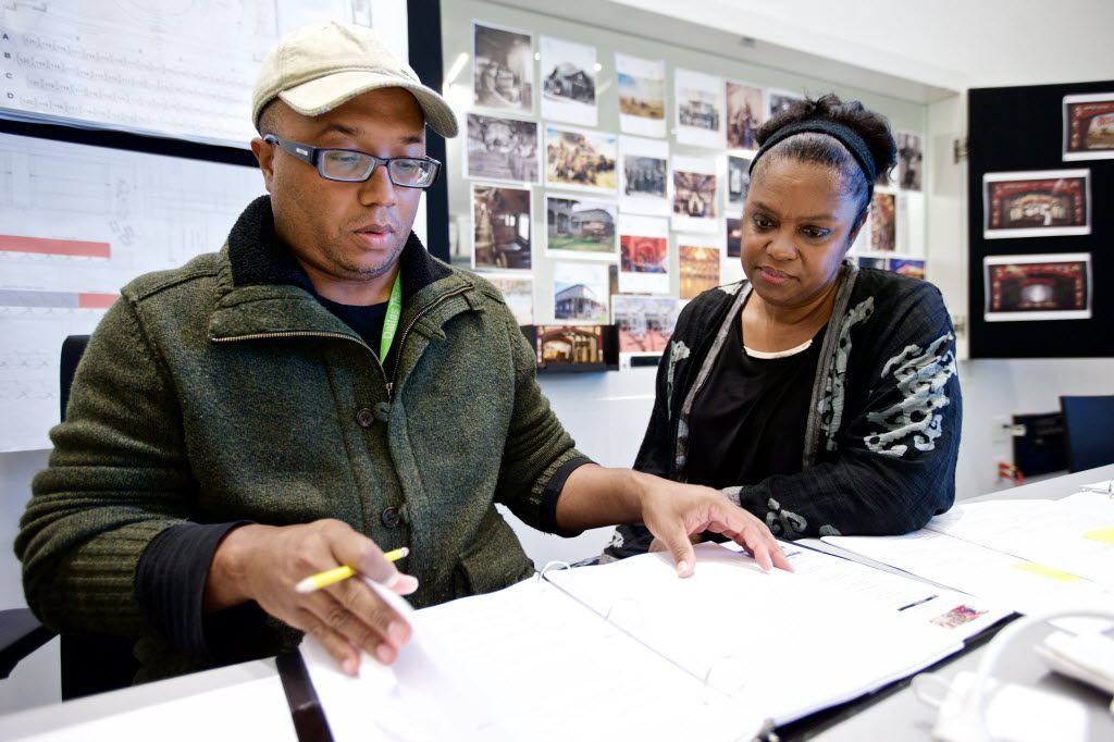 """Composer/writer/lyricist Kirsten Childs, right, and director Robert O'Hara look over materials for the world premiere musical """"Bella: An American Tall Tale"""" at the Wyly Theatre."""