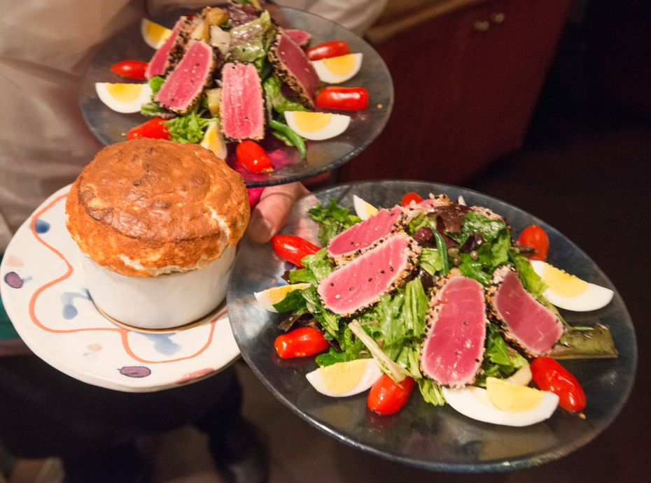 A soufflé and salads enroute to diners at the Inwood Village restaurant Rise Soufflé Salon in Dallas, Texas on December 20, 2017. (Robert W. Hart/Special Contributor)