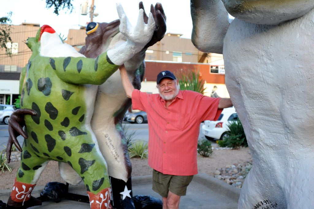 """Original artist of the Six Frogs Over Tango, Bob """"Daddy-O"""" Wade, stands next to the freshly painted 10-foot frogs in 2014 before they are hoisted to the permanent residence of what once was the legendary 80's night club Tango."""