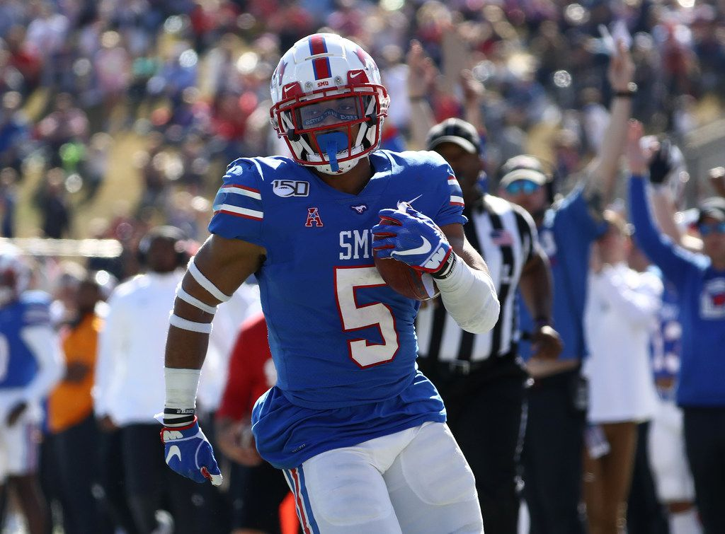 DALLAS, TEXAS - NOVEMBER 09:  Xavier Jones #5 of the Southern Methodist Mustangs runs for a touchdown against the East Carolina Pirates  in the second half at Gerald J. Ford Stadium on November 09, 2019 in Dallas, Texas. (Photo by Ronald Martinez/Getty Images)