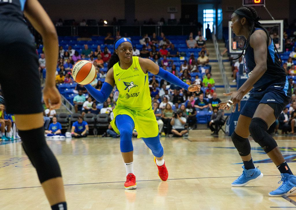 Dallas Wings guard Arike Ogunbowale (left) tries to pass the ball past Atlanta Dream center-forward Elizabeth Williams during the second quarter of a WNBA game between the Dallas Wings and the Atlanta Dream on Saturday, June 15, 2019 at College Park Center on the UTA campus in Arlington.  (Lynda M. Gonzalez/The Dallas Morning News)