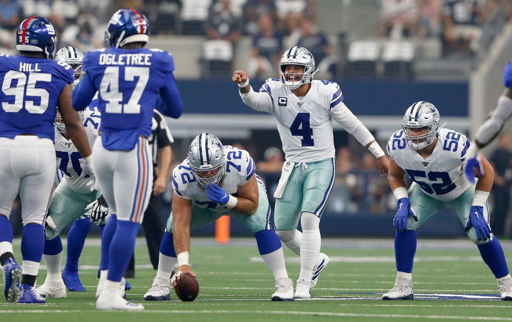 Dallas Cowboys quarterback Dak Prescott (4) points out players on the New York Giants defense before the snap during the first half of play in the home opener between the Dallas Cowboys and New York Giants at AT&T Stadium in Arlington, Texas on Sunday, September 8, 2019.