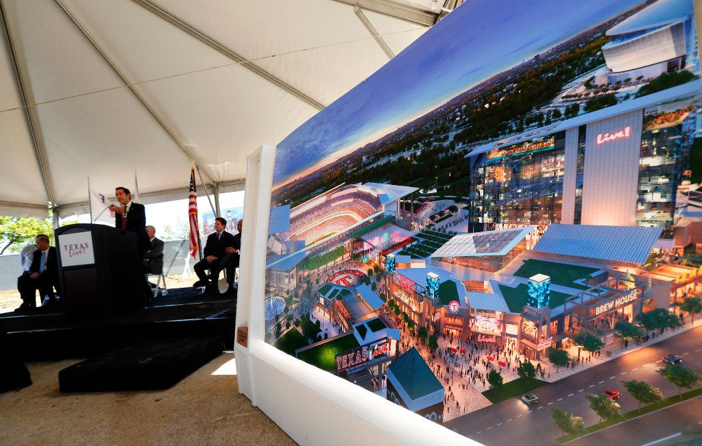 A large artist rendering of Texas Live! in Arlington, Texas, is on display during groundbreaking ceremonies. (Tom Fox/The Dallas Morning News)