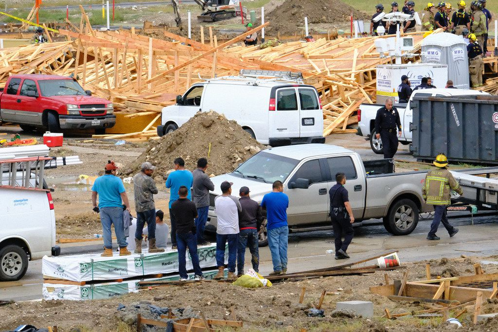Rescue crews went through the wreckage after a building under construction collapsed in West Dallas. One person died and five were hospitalized according to fire officials.  (Marcia L. Allert/The Dallas Morning News)