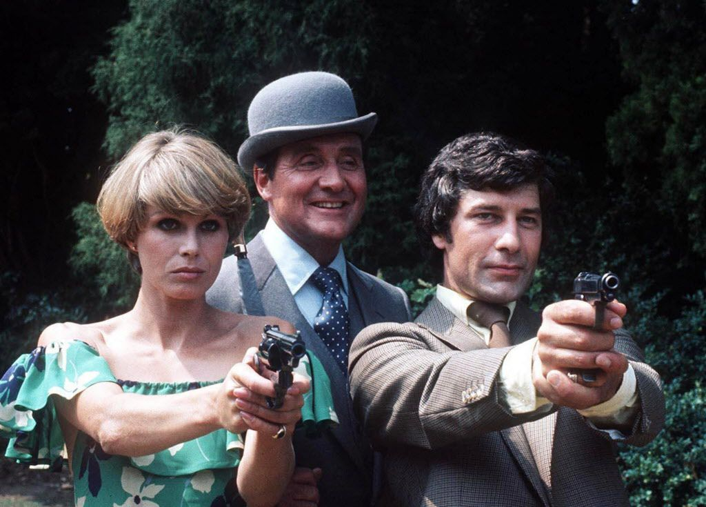 From left, Joanna Lumley as Purdey, Patrick MacNee as John Steed and Gareth Hunt as Mike Gambit are seen during the filming of The New Avengers at Pinewood Studios, Buckinghamshire, England, in this July 12, 1976 file photo. Gareth Hunt, 65, has died of cancer, his agent announced, Wednesday, March 14, 2007.