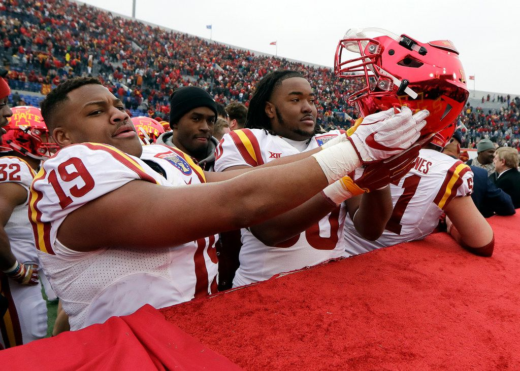 Iowa State defensive end JaQuan Bailey (19) holds his helmet upside down after Iowa State defeated Memphis 21-10 in the Liberty Bowl NCAA college football game Saturday, Dec. 30, 2017, in Memphis, Tenn. Bailey flipped the helmet upside down in response to Memphis players flipping over an Iowa State helmet during a pregame event. (AP Photo/Mark Humphrey)