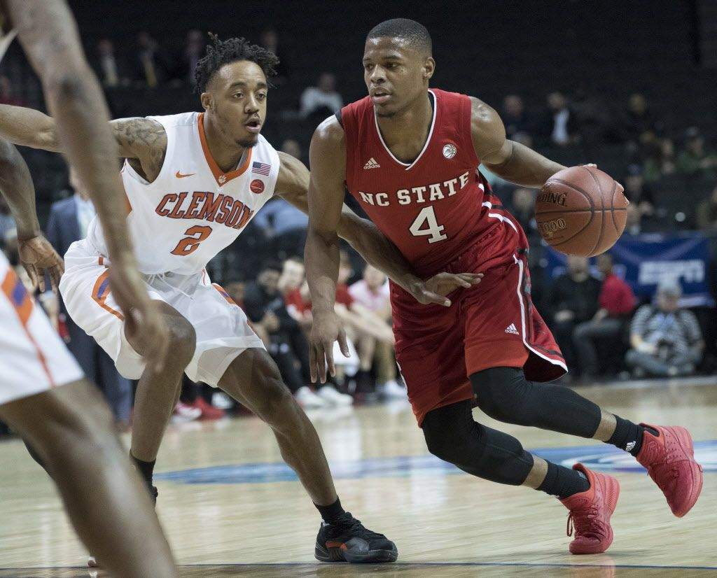 North Carolina State guard Dennis Smith Jr. (4) drives to the basket against Clemson guard Marcquise Reed (2) the first half an NCAA college basketball game in the Atlantic Coast Conference tournament, March 7, 2017, in New York. (AP Photo/Mary Altaffer) ORG XMIT: NYMA104