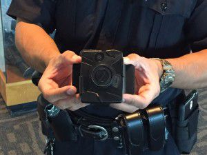 An officer holds a Taser Axon Flex body camera at Dallas Police Headquarters on Sept. 1, 2015, shortly after the police department began rolling out its camera program. (Tristan Hallman/Staff)