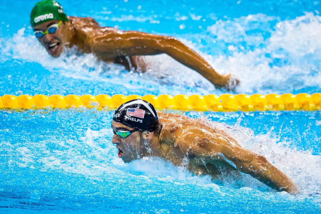 Michael Phelps of the USA leads Chad Guy Bertrand Le Clos of South Africa to the finish of the men's 200-meter butterfly final at the Rio 2016 Olympic Games. (Smiley N. Pool/Dallas Morning News)