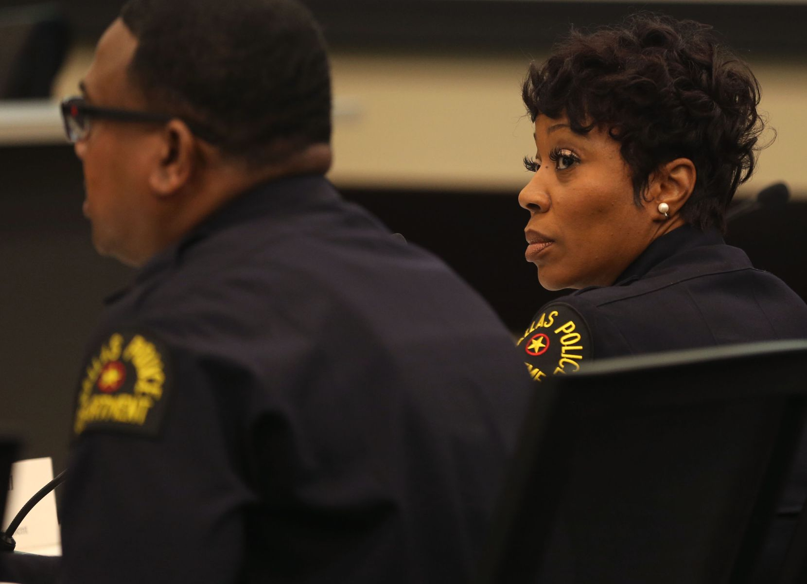 Dallas Police Chief U. Renee Hall listened as Lt. David Davis made a presentation during a Dallas City Council committee briefing Monday.