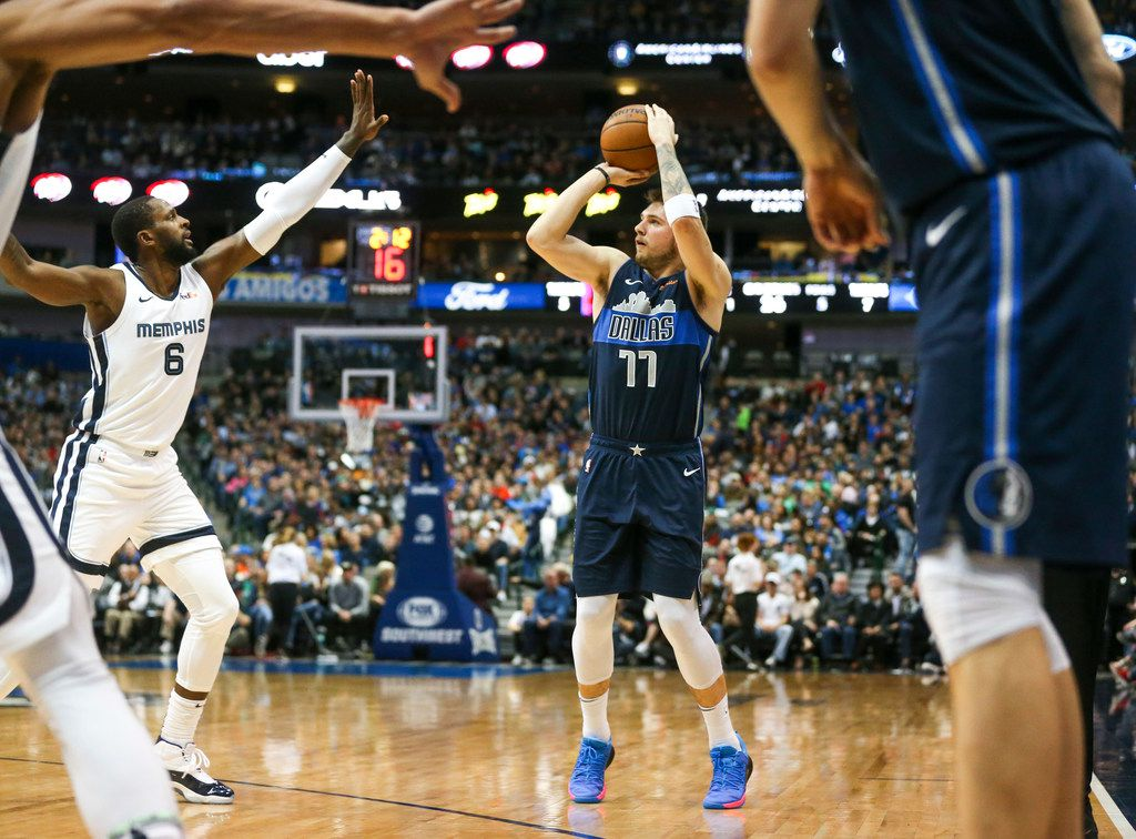 Dallas Mavericks forward Luka Doncic (77) shoots over Memphis Grizzlies forward CJ Miles (6) during an NBA basketball game at American Airlines Center in Dallas on Saturday, March 2, 2019. (Shaban Athuman/The Dallas Morning News)