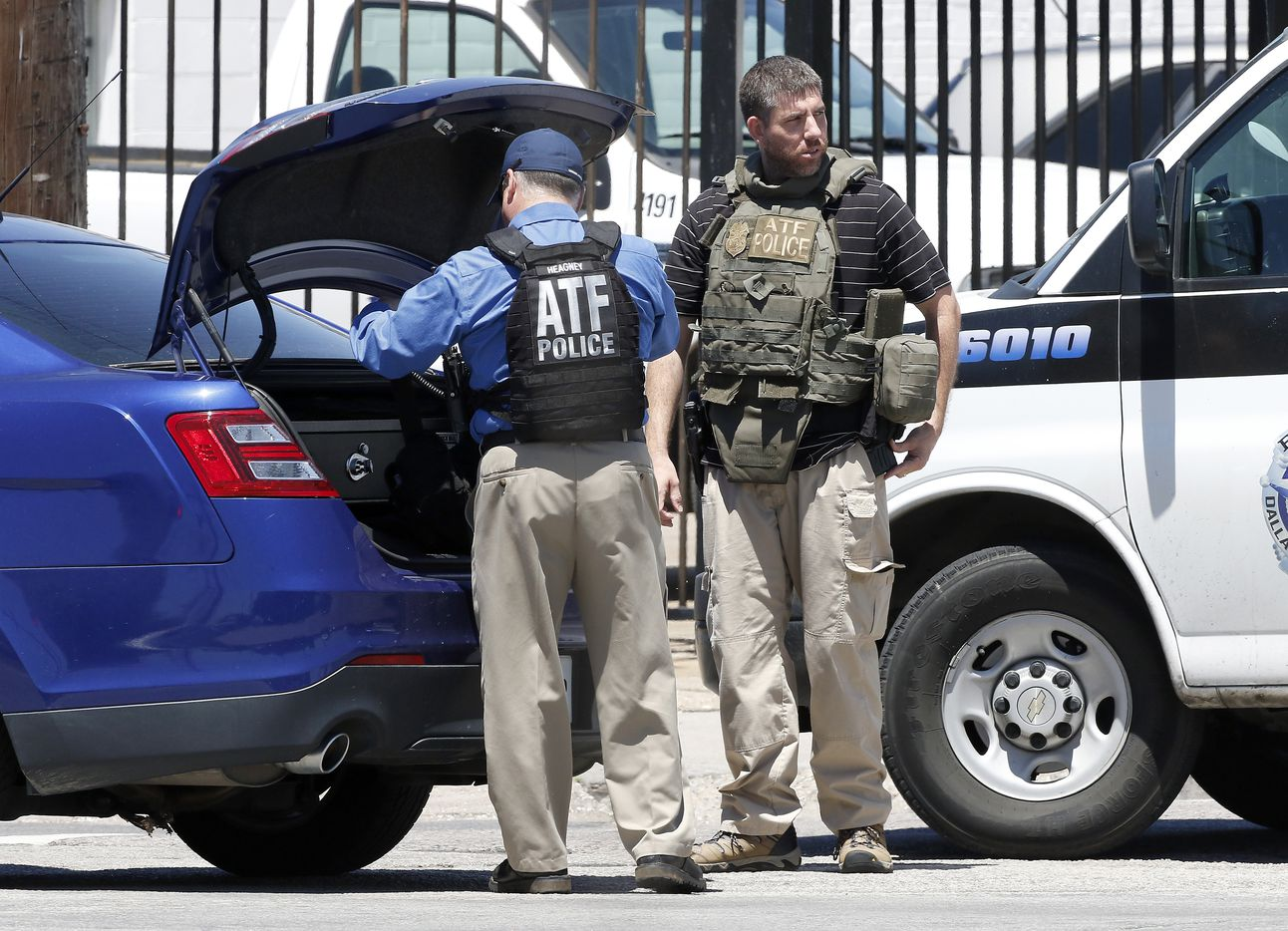 Two ATF agents arrive at the active shooting scene where a Dallas Fire-Rescue paramedic has been shot on Dolphin Road in Dallas, Monday, May 1, 2017. (Jae S. Lee/The Dallas Morning News)
