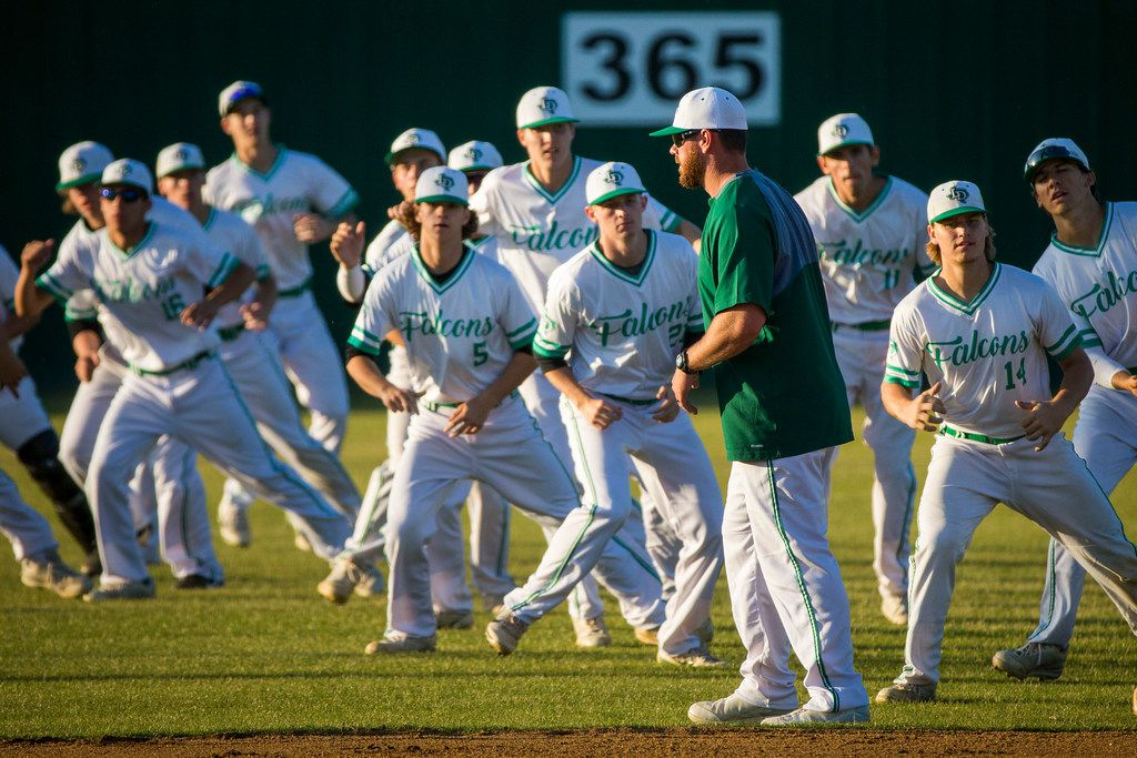 Lake Dallas coach Ryan Howard watches his players warm up before a District 14-5A baseball game against Prosper on Friday, April 27, 2018, in Corinth, Texas. (Smiley N. Pool/The Dallas Morning News)