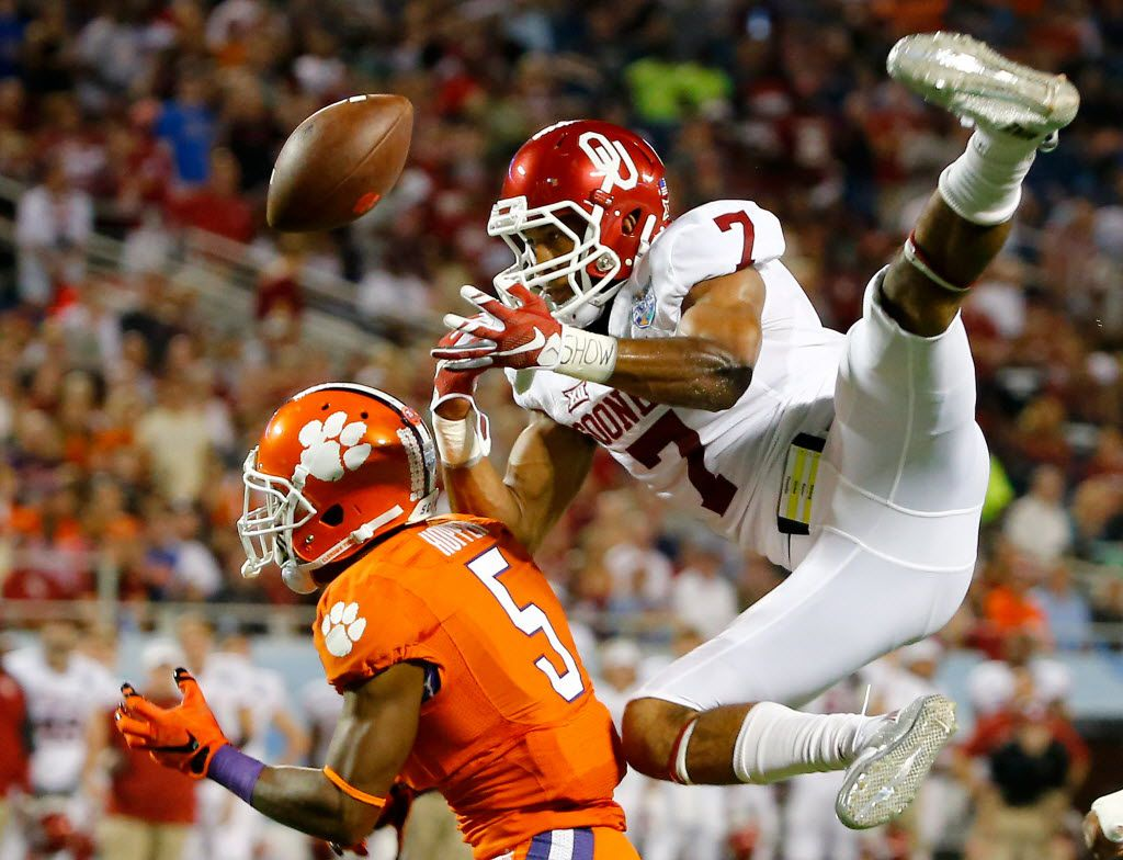 ORLANDO, FL - DECEMBER 29:  Germone Hopper #5 of the Clemson Tigers attempts a reception against Jordan Thomas #7 of the Oklahoma Sooners during the Russell Athletic Bowl at Florida Citrus Bowl on December 29, 2014 in Orlando, Florida.  (Photo by Sam Greenwood/Getty Images) 12302014xSPORTS