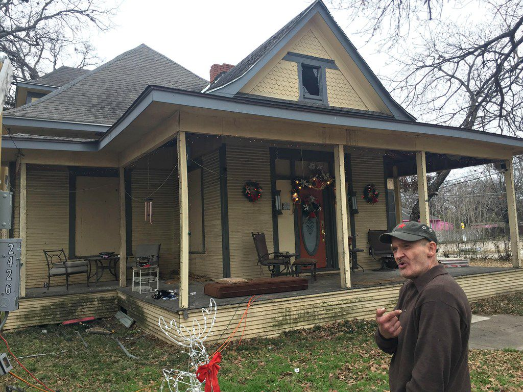 A photo taken in December 2017 shows John Grindle in front of the 114-year-old house at 2426 Pine St. He said then, and this week, he had hoped to have it restored by next year.