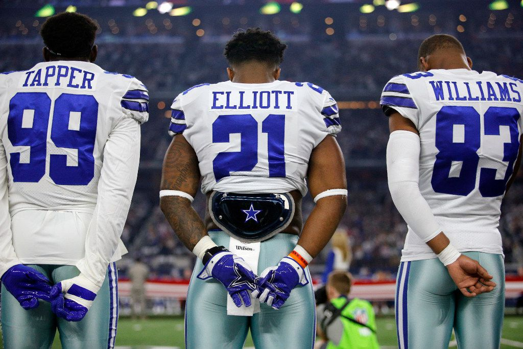 Dallas Cowboys defensive end Charles Tapper (99), running back Ezekiel Elliott (21) and wide receiver Terrance Williams (83) stand for the national anthem before facing the New York Giants at AT&T Stadium in Arlington, Texas, Sunday, September 10, 2017. (Tom Fox/The Dallas Morning News)