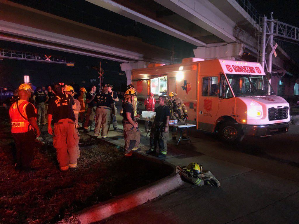 Salvation Army crews provide water, gatorade and snacks to first responders and resident affected by Sunday evening's tornado in North Dallas.