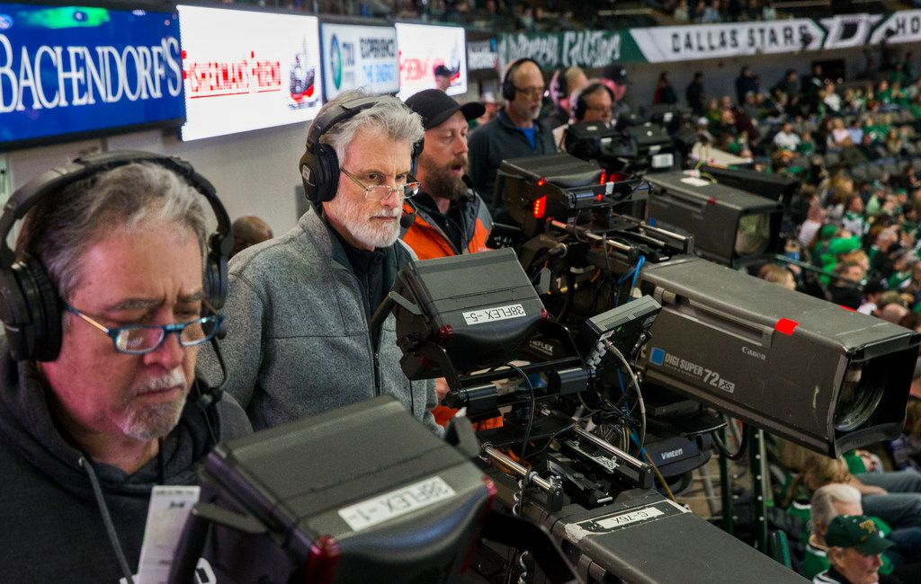 From left, camera operators Dave Curliss, Bruce Deck, and Peter Wagner shoot Fox Sports Southwest's television coverage of a hockey game between the Dallas Stars and the Vancouver Canucks at the American Airlines Center in Dallas on Sunday, March 17, 2019.  (Daniel Carde/The Dallas Morning News)