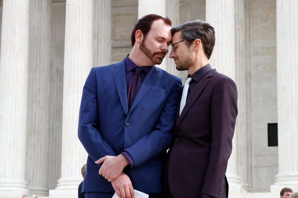 The Supreme Court is setting aside a Colorado court ruling against a baker who wouldn't make a wedding cake for Charlie Craig (left) and David Mullins. But the court is not deciding the big issue in the case, whether a business can refuse to serve gays and lesbians.