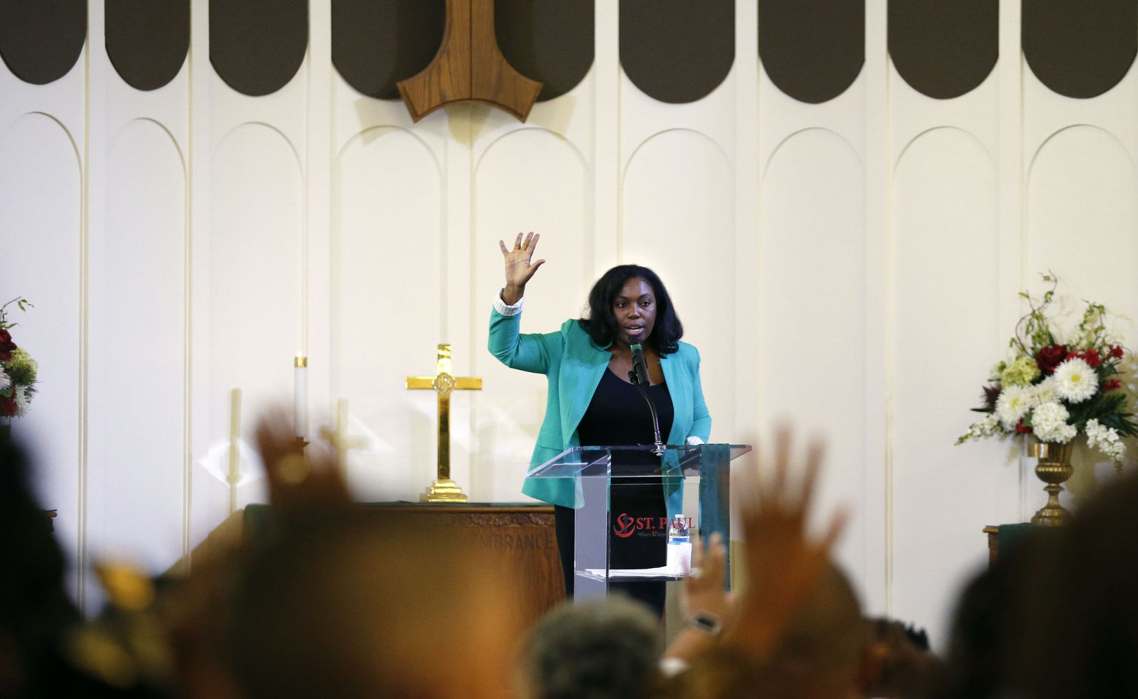 Frances Waters speaks to the congregation at St. Paul United Methodist Church in Dallas. (Vernon Bryant/Staff Photographer)