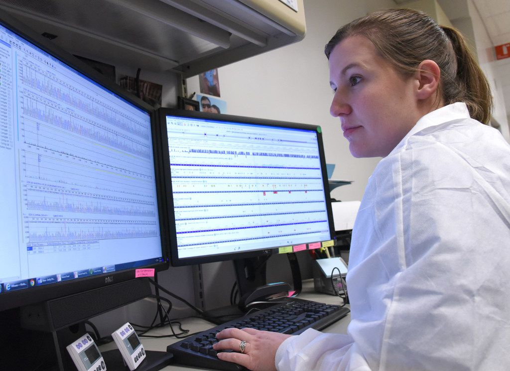 A medical technologist analyzes results from the Sanger sequencing. If the variant is confirmed, the lab will include it in a report for final review.