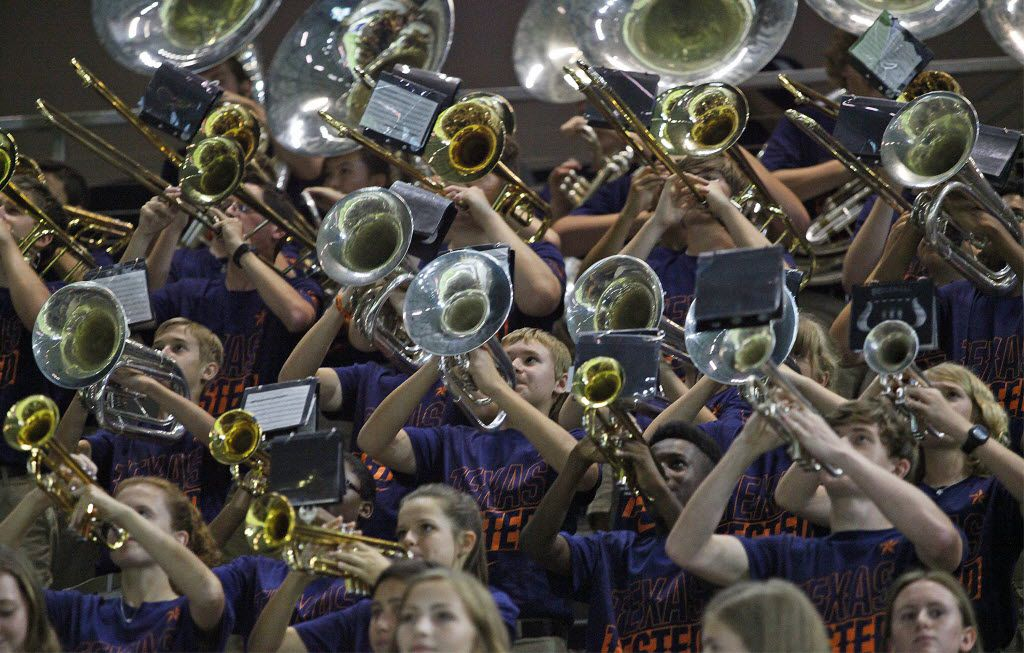 The Wakeland High School marching band performed as Liberty High School played Wakeland at The Star in Frisco last August.