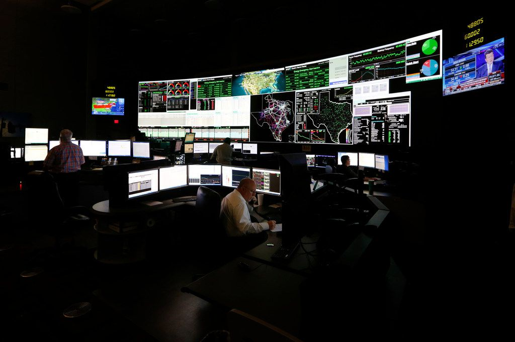 System operators work in the command center of the Electric Reliability Council of Texas in Taylor. About 90 percent of Texas' electric load is managed by ERCOT.