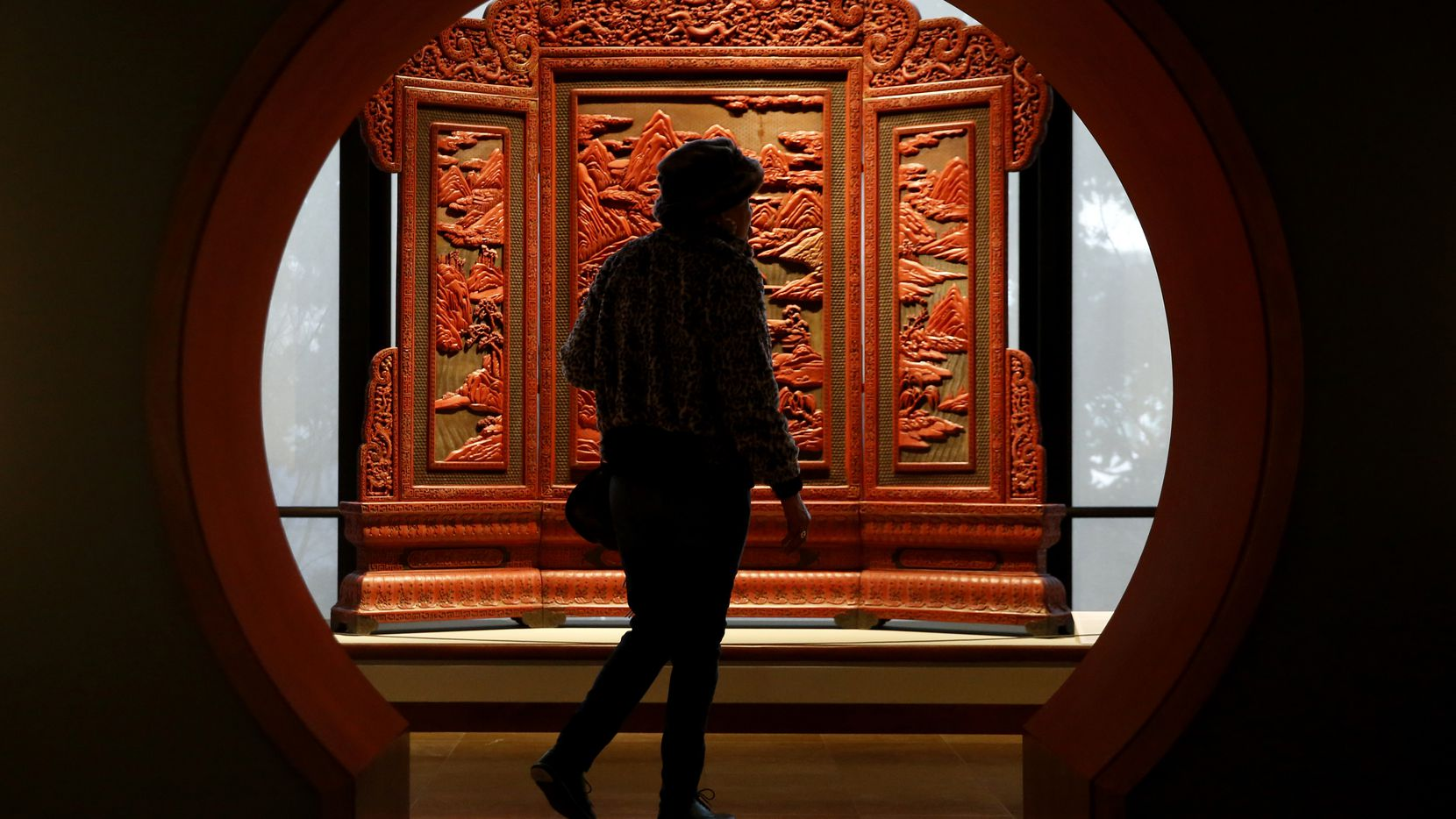 Florence Barnett walks past a lacquered screen at the Crow Museum of Asian Art in Dallas on Jan. 24, 2019.