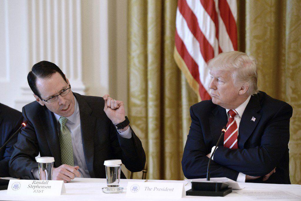 "President Donald Trump praised AT&T boss Randall Stephenson for doing ""really a top job."""