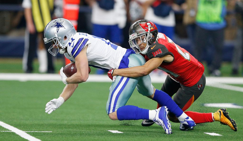 Dallas Cowboys wide receiver Cole Beasley (11) makes the first down as Tampa Bay Buccaneers cornerback Brent Grimes (24) tackles him during the second half of play at AT&T Stadium in Arlington on Sunday, December 23, 2018. Dallas Cowboys defeated the Tampa Bay Buccaneers 27-20 to capture the NFC East. (Vernon Bryant/The Dallas Morning News)