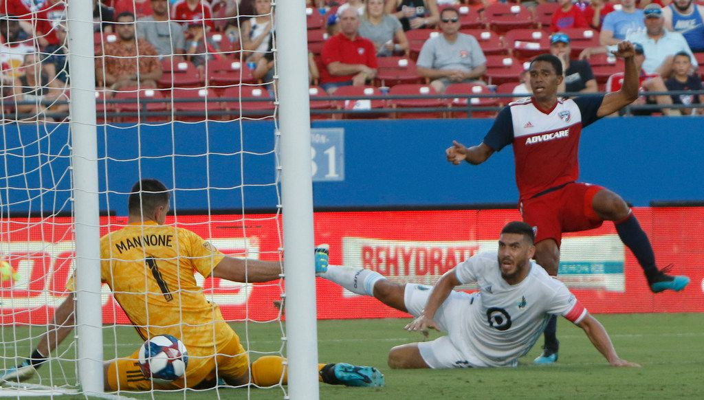 FC Dallas defenseman Reggie Cannon (2) watches as his shot makes its way past the defense of Minnesota United FC defenseman Michael Boxall (15) and goal keeper Vito Mannone (1) for a game tie splitting score late in the first half of play. FC Dallas won the contest, 5-3. The two MLS teams competed in their match which was held at Toyota Stadium in Frisco on August 10, 2019. (Steve Hamm/ Special Contributor)