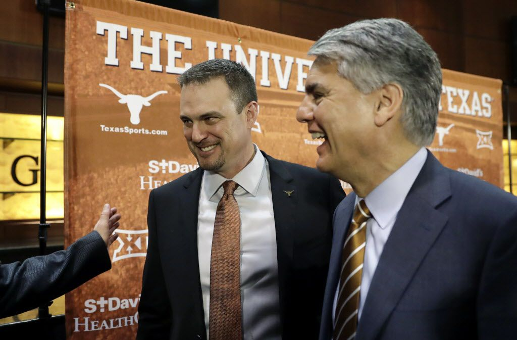 New Texas head NCAA college football coach Tom Herman, left, and president Gregory Fenves, right, leave a news conference where Herman was introduced to the media, Sunday, Nov. 27, 2016, in Austin. (AP Photo/Eric Gay)