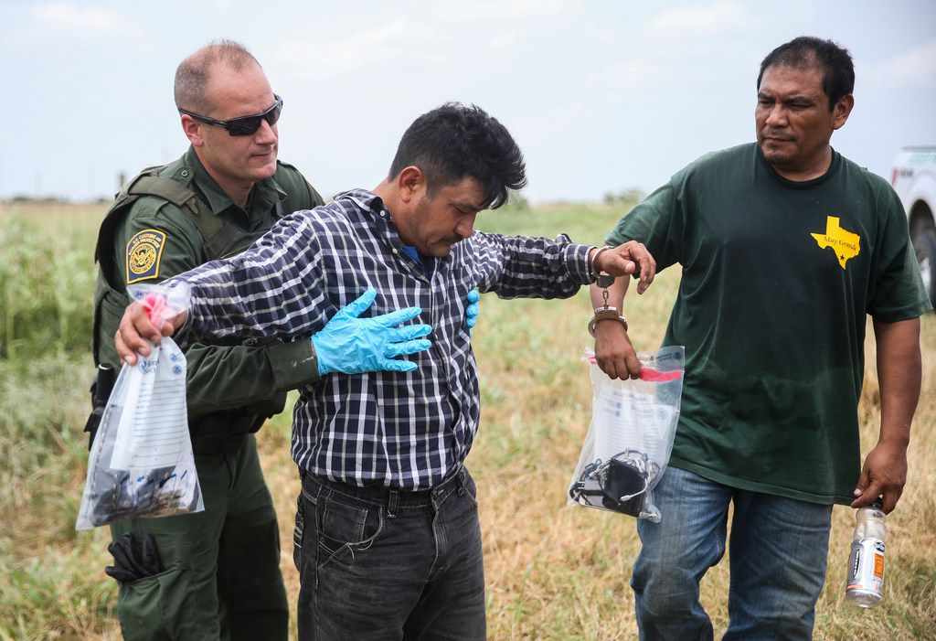 A group of immigrants who illegally crossed the border from Mexico into the United States are apprehended by Border Patrol agents on Friday, May 3, 2019 near McAllen, Texas. (Ryan Michalesko/The Dallas Morning News)