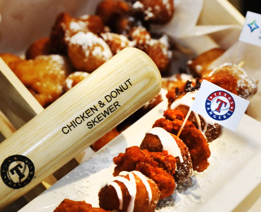 The Chicken and doughnut skewer is a 12-inch stick with doughnut holes and fried chicken drizzled with sweet & spicy buffalo honey sauce. Located at Flew the Coop in section 50.