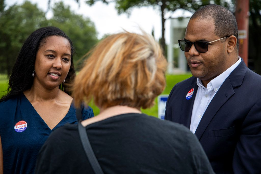"""Nakita """"Nikki"""" Johnson and state Rep. Eric Johnson chat with Nancy Hart as she makes her way to cast her vote at Samuell Grand Recreation Center in Dallas on Tuesday, May 28, 2019."""