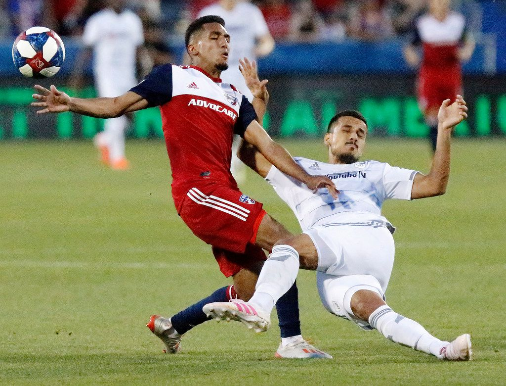 FC Dallas forward Jesus Ferreira (27) and Los Angeles FC defender Mohamed El-Munir (13) colide during the second half as FC Dallas hosted LAFC at Toyota Stadium in Frisco on Sunday, May 19, 2019.  (Stewart F. House/Special Contributor)