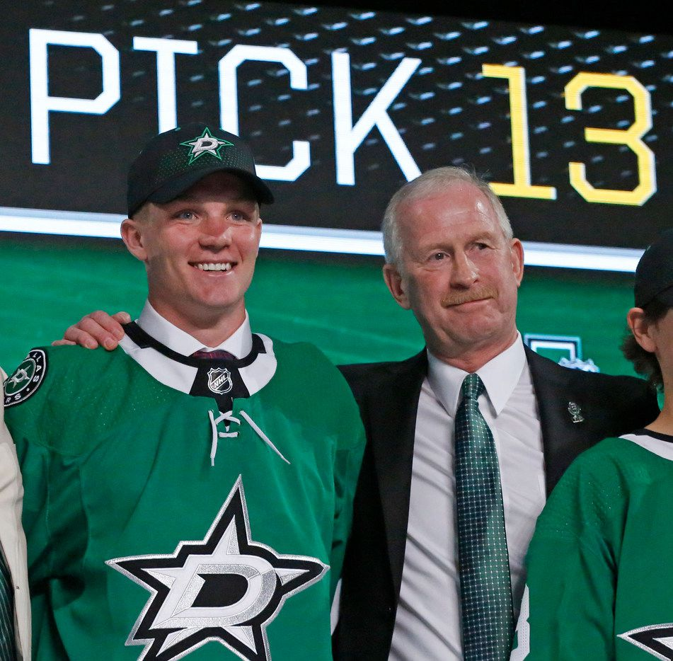 Dallas Stars first round draft pick Ty Dellandrea stands with General Manager Jim Nill at the 2018 National Hockey League draft held at the American Airlines Center in Dallas on Friday, June 22, 2018. (Louis DeLuca/The Dallas Morning News)