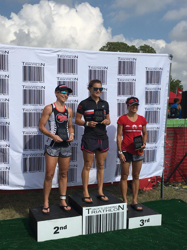 Brandi Grissom Swicegood at the podium of Jake's Generic Triathlon in Austin. Swicegood placed second, with her teammate, Haley Koop, who won the race, and third-place finisher, Missy Ruthven.
