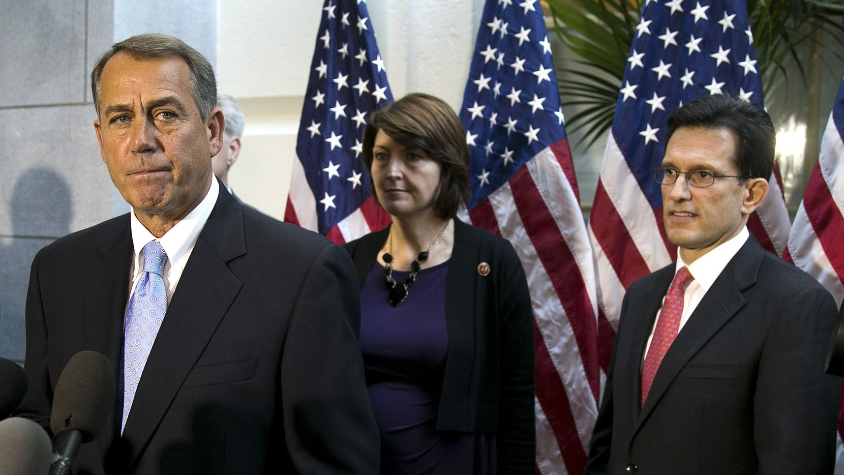 House Speaker John Boehner (R-Ohio) speaks at a news conference following a caucus meeting at the Capitol, in Washington, Oct. 15  2013. Republican leaders struggled to craft a proposal to end the government shutdown and change the health care law on Tuesday, after a plan presented to the rank and file failed to win enough support. From right: House Majority Leader Eric Cantor (R-Va.), Rep. Cathy McMorris Rodgers (R-Wash.) and Boehner. (Doug Mills/The New York Times)