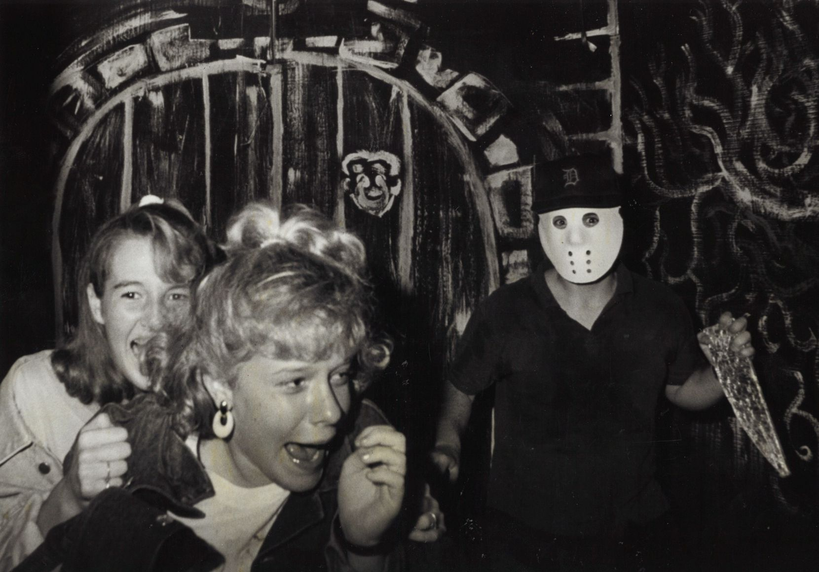 Amy Hasty grabs her friend Amy Mitchell as they run from one of the actors in a darkened hallway of the March of Dimes Haunted House on Oct. 16, 1987.
