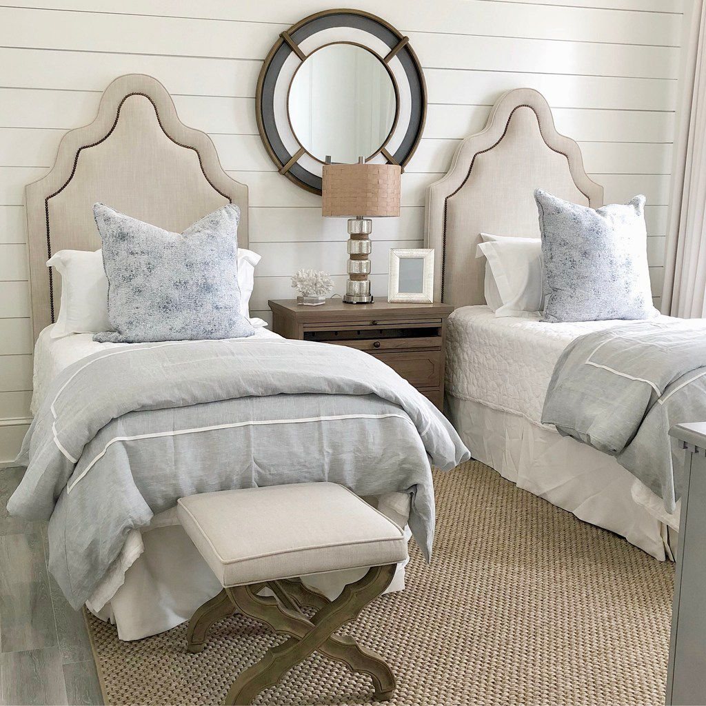 Emily Sheehan Hewett used subtle nods to the sea, decorative coral and a porthole-style mirror to play up the guest room's oceanside location.