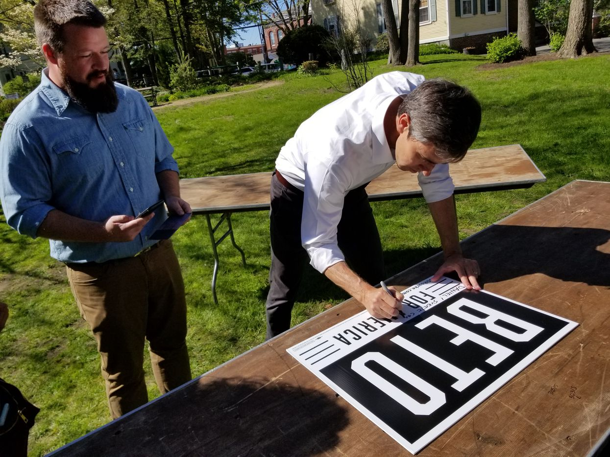 """Beto O'Rourke autographs a campaign sign after an outdoor town hall event in Exeter, N.H., at Town Hall Common on May 11, 2019. He wrote """"Daniel! Suerte con todo! Beto."""" (""""Good luck with everything!"""")"""
