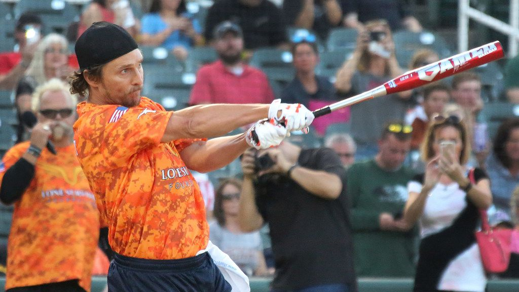 Actor Matthew McConaughey takes some swings during the Red River celebrity softball game home run contest at the Dr. Pepper Ballpark in Frisco, Texas on Thursday, October 12, 2017. (Louis DeLuca/The Dallas Morning News)
