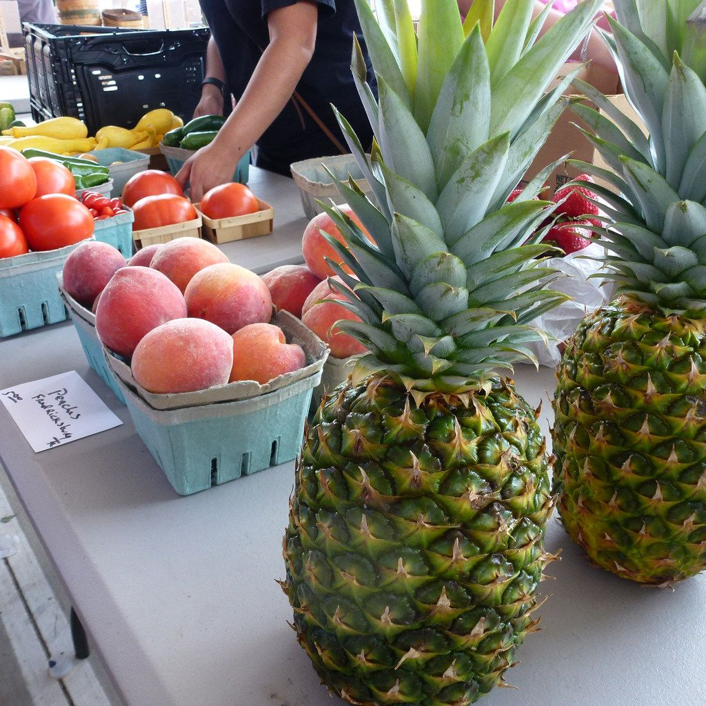 Frisco Fresh outdoor market is not about strictly local products and produce. Beautiful, fuzzy Fredericksburg peaches are displayed next to pineapples, which grow only in tropical climates.