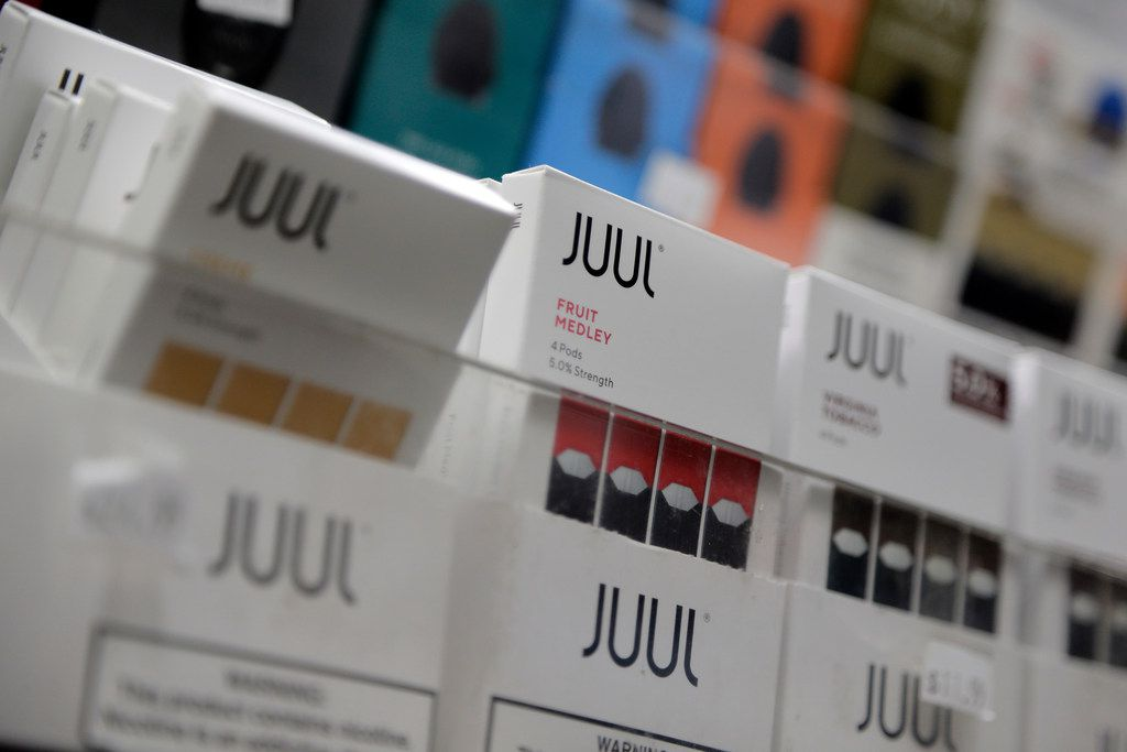 Texas buyers of vape products and e-cigarettes like these Juul products displayed at a New York shop Dec. 20, 2018, would have to pay a 10 percent excise tax on retail purchases under legislation offered by Rep. Rick Miller, R-Sugar Land. A companion measure from Sen. Nathan Johnson, D-Dallas,  was touched off by a Dallas health care advocate.
