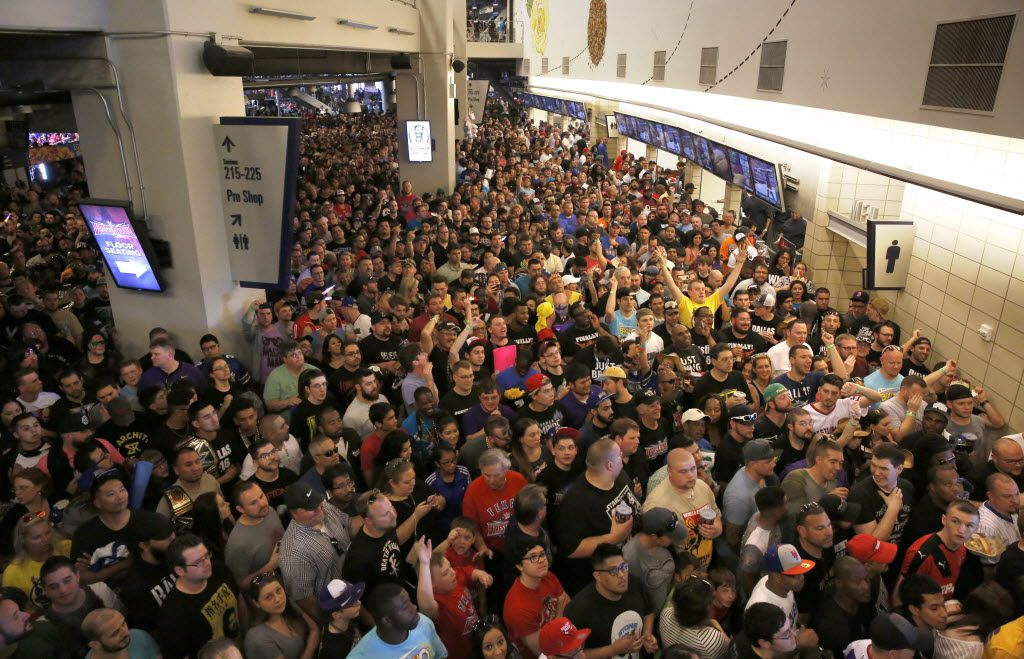 WWE fans fill the concourse before WrestleMania 32 at AT&T Stadium in Arlington, TX, Sunday, April 3, 2016. (David Guzman/The Dallas Morning News)