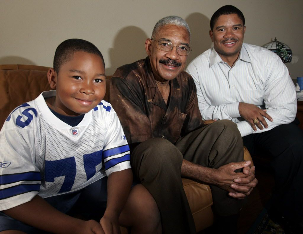 Dallas Cowboy legend Jethro Pugh (center) poses with his son Trey (right) and his grandson Jacob, 8 (left), at Pugh's home in east Dallas on Wednesday, September 6, 2006. Grandson Jacob is a nose guard on his youth team and sports his grandfather's old number 75. His team is scheduled to play a game at Texas Stadium soon.